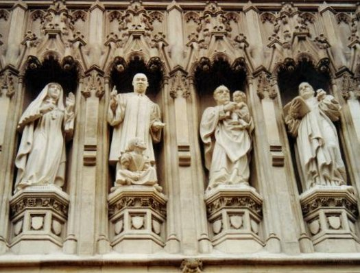 Four of the ten 20th Century Martyrs above the west door of Westminster Abby, installed in 2000. From left to right: Grand Archduchess Elizabeth of Russia, Martin Luther King, Jr., Bishop Romero, Pastor Bonhoeffer