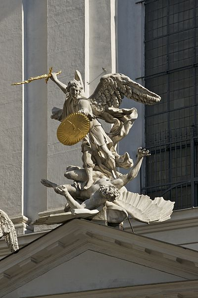 Archangel Michael defeating evil, at the Michaelkirche close to Hofburg imperial palace in Vienna