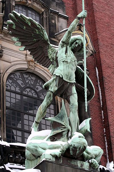 Statue of Archangel Michael by August Vogel over the portal of St. Michael's in Hamburg, Neustadt